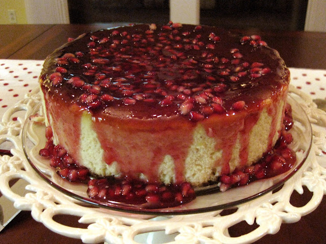 gingersnap crust cheesecake with rum cheesecake batter, nutmeg and pomegranate cheesecake glaze