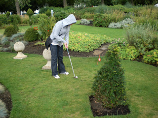 Emily playing the Adventure Golf Grass Putting course at Hyde Park, London.