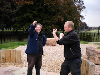Chris 'Stretch' Jones - 2006 World Conkers Champion - holding out his conker for enhancement talent Brad 'The Fist' Shepherd to take a shot