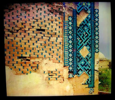 Colorful tile wall with patches of mortar in spots
