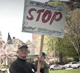 Man holding sign that says No taxization STOP without representation
