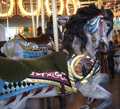 Carousel horse with an Indian chief's head with headress on the side