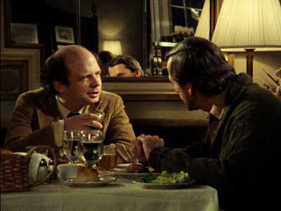 Wallace Shawn at left having dinner with Andre