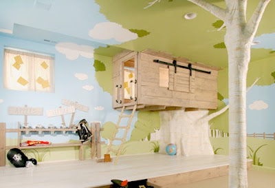 Photo of a child's fantasy room, featuring an indoor treehouse and walls painted to look like a forest