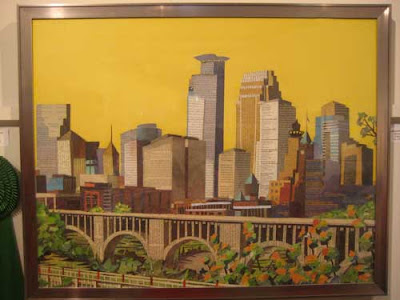 Downtown Minneapolis in yellows, tans, greens and browns