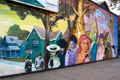 Colorful painted mural on a brick wall