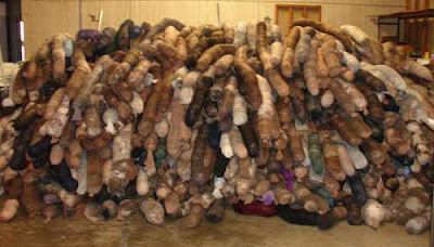 Huge pile of hair booms in a warehouse