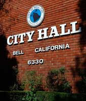 Brick wall with the words City Hall Bell California on it
