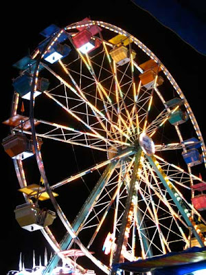 Ferris wheel with primary colored seats