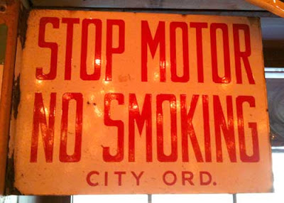 Old gas station sign warning about turning off engines and now smoking, extremely condensed but readable