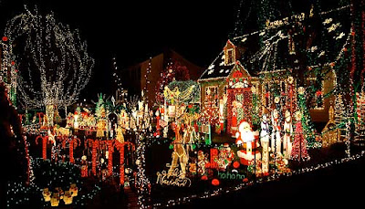 Festooned Christmas lights and figures on a house