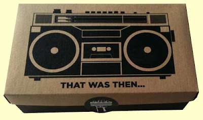 Jambox package, brown shoebox lid with black boombox illustration, black bottom on the box