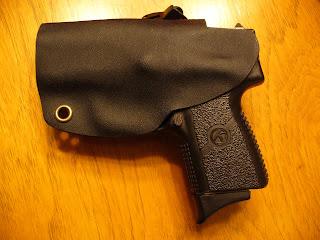 Hidden Defense: Grip Clip Holster for a Kahr PM9