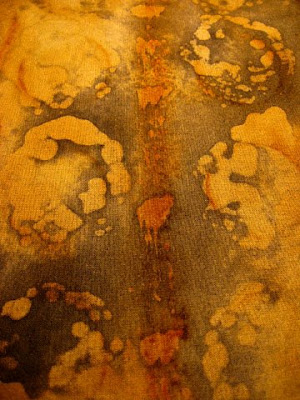 Rust dyed and batiked fabric