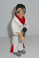 Aaron is an Elvis Impersonator Hitty doll friend created by Wanda Harrigan of Wild Hare Studio Designs
