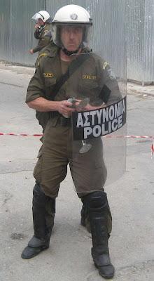 mat dianoitika kathisterimenos retarded riot cop in greece