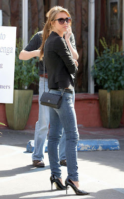 5622c228ba37 Lauren Conrad is still carrying her vintage Jumbo XL Chanel quilted bag and  Audrina Patridge was seen carrying a cross body mini version of ...