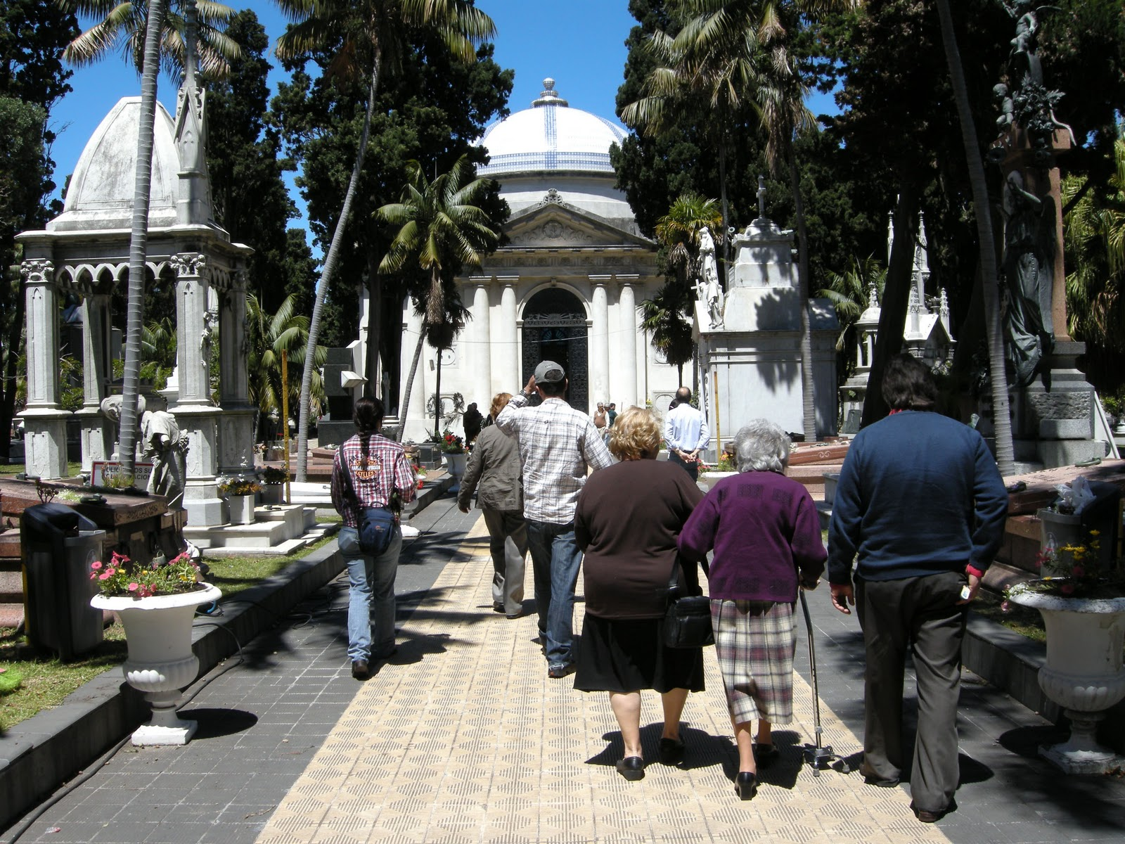 eye on uruguay the day of the dead a photo essay the central tree lined path leads to a sepulchre
