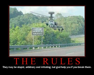 picture of a Apache helicopter hovering over a speed enforcement sign