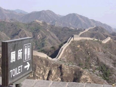photo of a toilet sign on the great wall of china