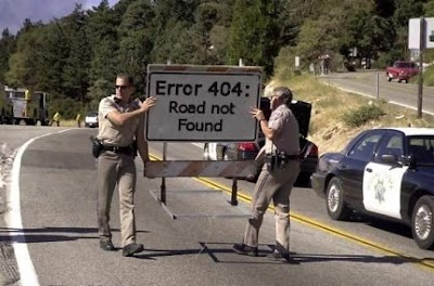 photo of CHP officers carrying a 404 road not found sign