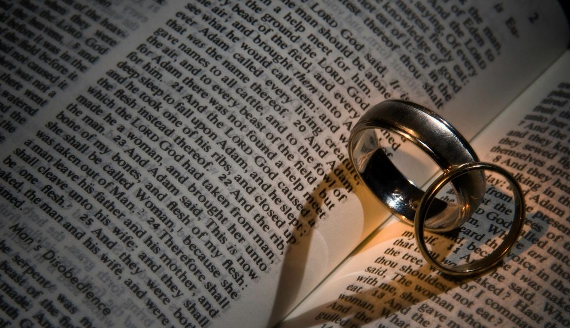 Nieceys blog Two wedding rings and roses on a bible with Genesis