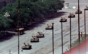 A single man blocks a column of PLA tanks east of Tiananmen Square in Beijing June 5, 1989