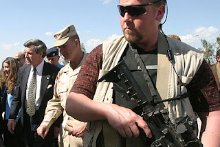 Bosom Buddies: L Paul Bremer and Blackwater Guards (AP Photo)