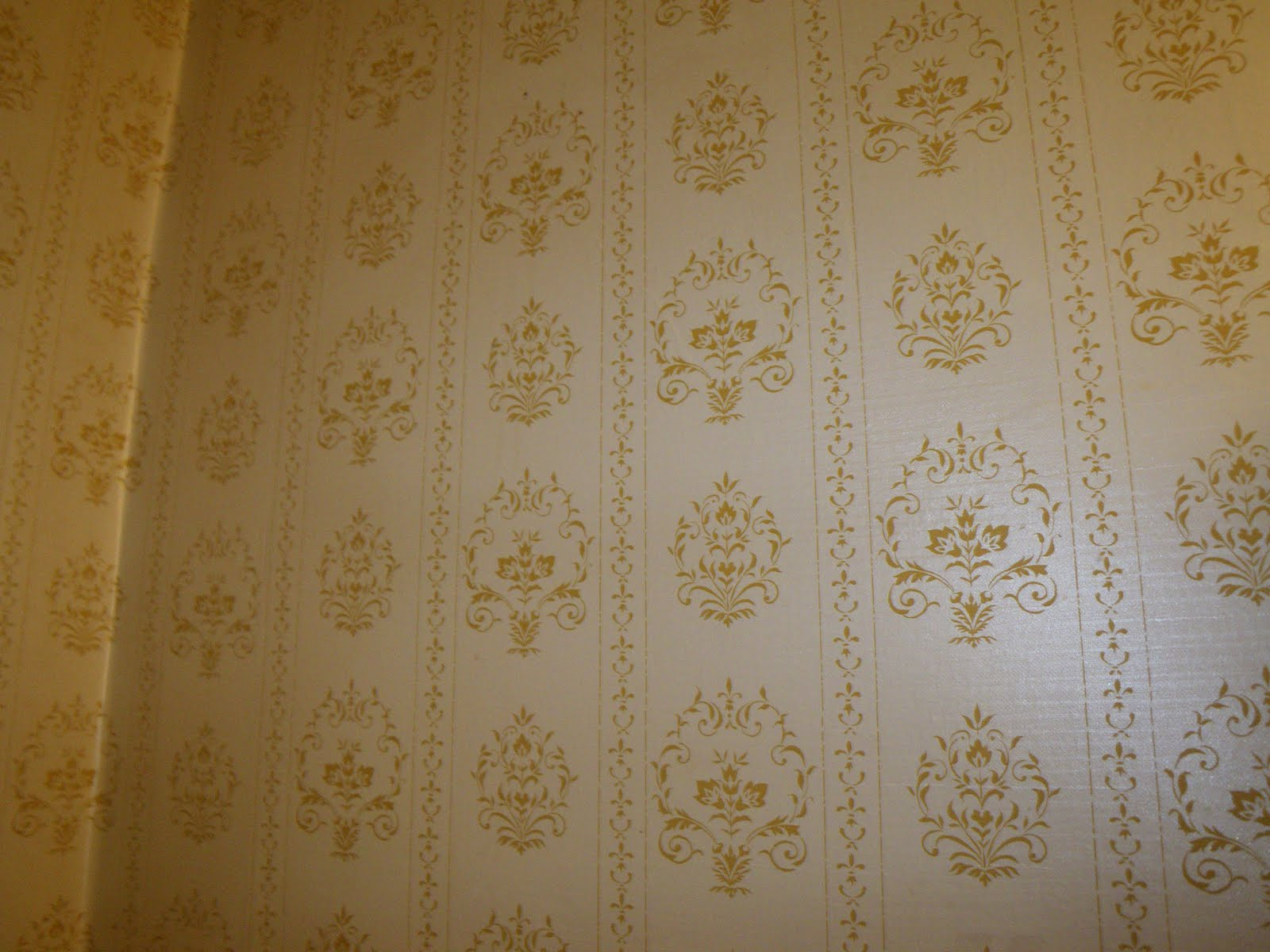 Wallpaper was a shiny dark yellow and cream damask. I doubt it was