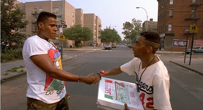 'Aiiight, Radio Raheem, I feel ya, man. Now can you take it easy on my hand? I need it for delivering this pizza.'