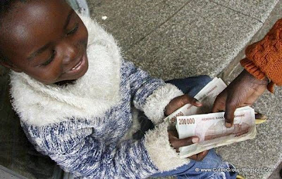 Here is a boy getting change in 200 000 dollar notes!