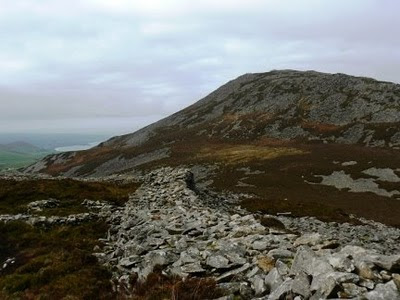 The ramparts on Tre'r Ceiri backed by Yr Eifl