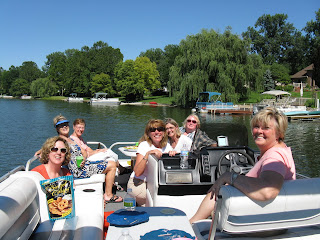Boating and dining with friends on a pontoon boat