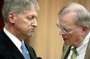 Former Durham DA Mike Nifong, talks with his attorney Jim Glover during criminal contempt hearing