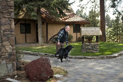 Greg Steckler -- the sole resident, with his wife and mother-in-law, of Bend's hobbit-themed Shire development -- plays with his dog, Wally.