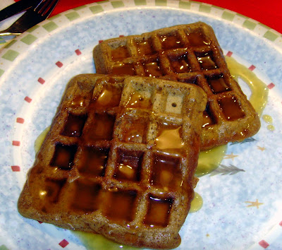 Two gingerbread waffles on a plate