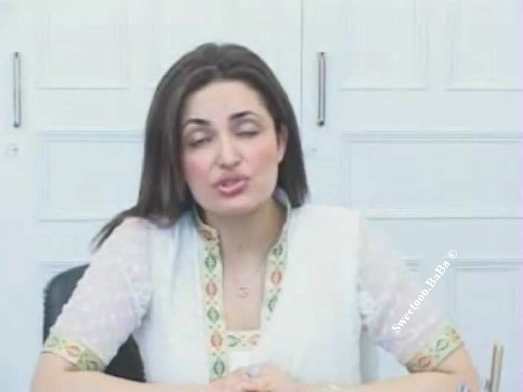 Fazeela abbasi holding left boob