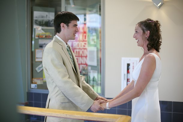 John and Ellie laughing in the Milwaukee Transit Center before their wedding