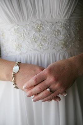Bride clasps hands on wedding day