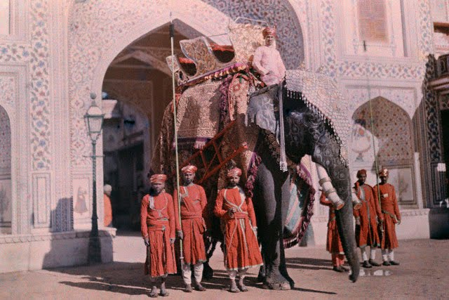 A royal elephant flanked by guards awaits the Maharaja - 1929