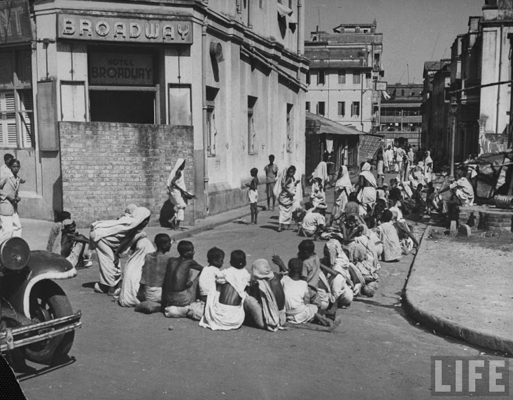Starving Hindus waiting for the government controlled Grain Shop to open