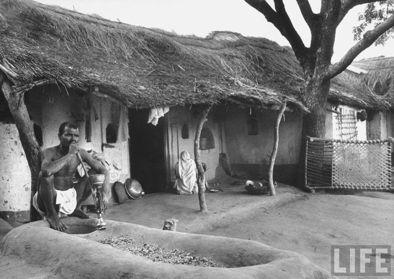 Indian farmer smoking his hookah or water pipe - 1962