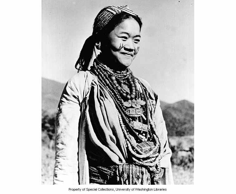 Aka woman with face paint and Tibetan ornaments, Jamiri village, India, ca. 1954