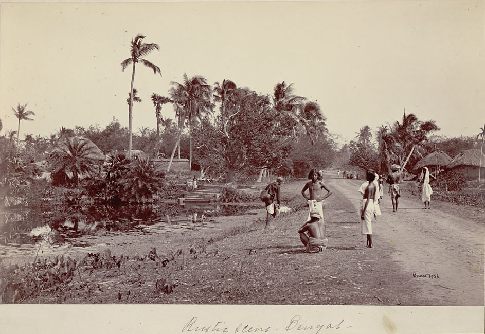 Bengali Men in Costume by Pond Near Village of Mud and