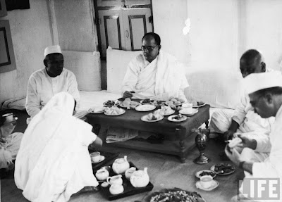 Pro-Japanese, anti-British Indian Nationalist leader Subhas Chandra Bose (C) enjoying a meal at Bardoli Ashram on his way to the 51st Indian National Congress during WWII in 1940.