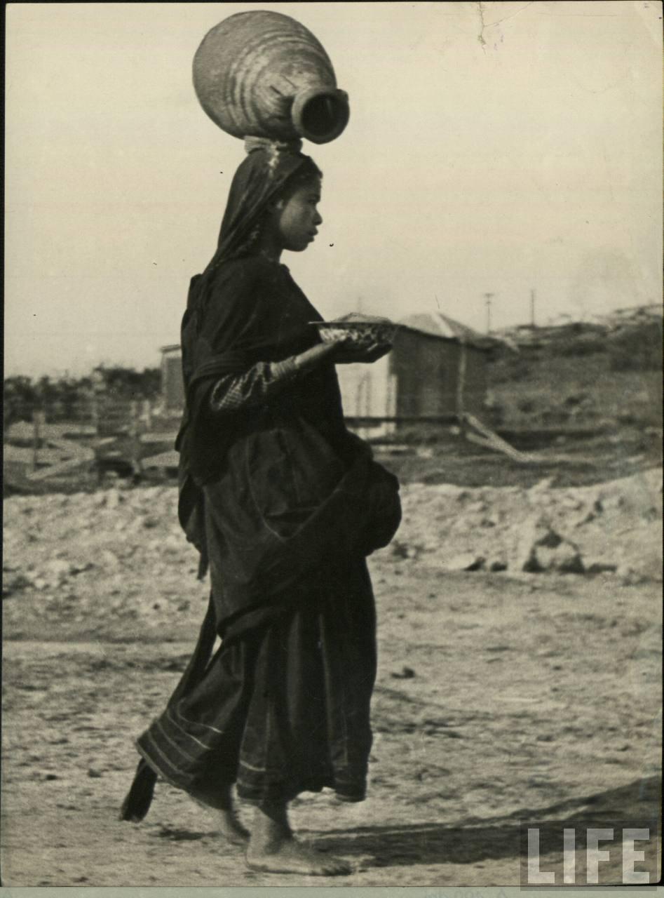 Indian Woman Carrying a Pot