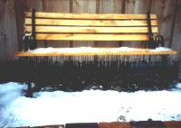 Bench with snow and icicles