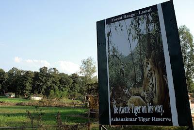 A hoarding at a village on the Bilaspur - Amarkantak highway in Achanakmar tiger reserve, Chattisgarh