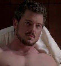 eric dane showing some flesh/with beard + mustache