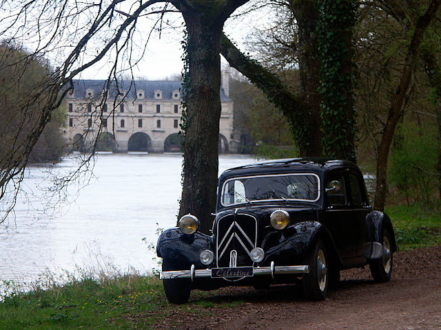 Citroen Traction Avant with the Chateau of Chenonceau.  Indre et Loire, France. Photographed by Susan Walter. Tour the Loire Valley with a classic car and a private guide.